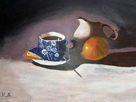 Still life with cup of coffee and lemon